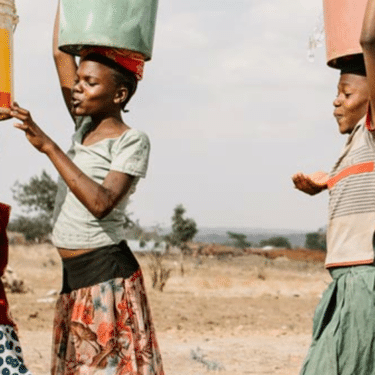 Young girls collecting water